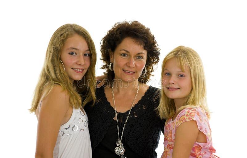 Moeder met haar twee dochters stock foto