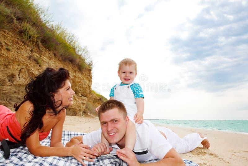 Moeder, vader en baby stock fotografie