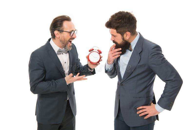 Moedig discipline aan Bedrijfsmensenformele kleding die verschillend advies over tijd hebben Tijdbeheer en discipline stock afbeelding