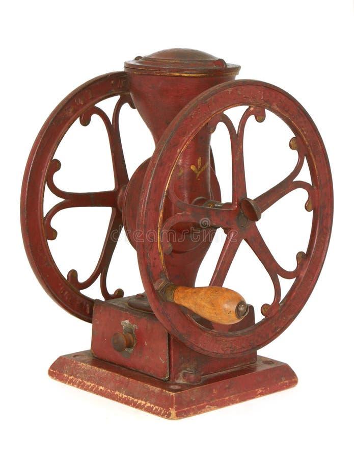 Moedor de café vermelho antigo da roda do tabletop do ferro foto de stock royalty free