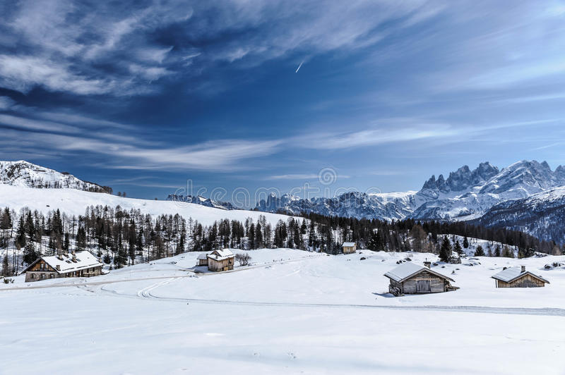 Moena Alpine landscape. Snow covered Alpine landscape of Moena with chalet buildings in the background, Trentino, Italy stock photo