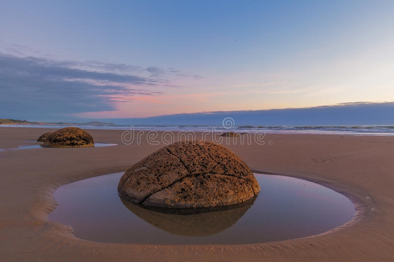 Moeraki Boulder closeup at low tide, Koekohe beach, New Zealand. Moeraki Boulder closeup at sunrise, Koekohe beach,Otago, South Island, New Zealand stock images