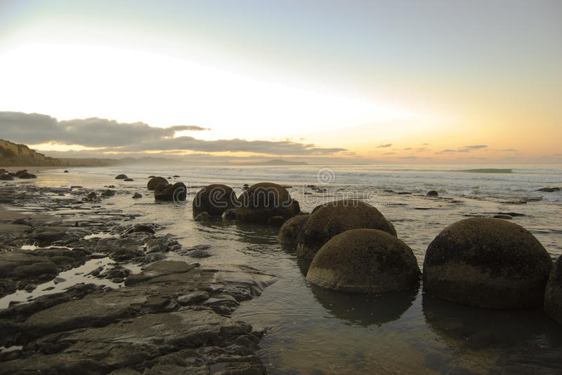 Moeraki Boulders. The moeraki boulders on a beach on the south island of New Zealand stock images