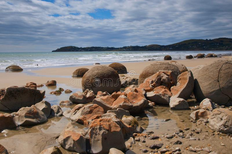 Moeraki boulders on beach. Moeraki boulders famous geological feature near Christchurch, New Zealand stock photography