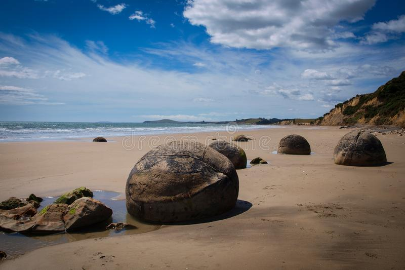 Moeraki boulders geological phenomena. Moeraki boulders, a strange geological phenomena at a sunny beach near Dunedin royalty free stock photos