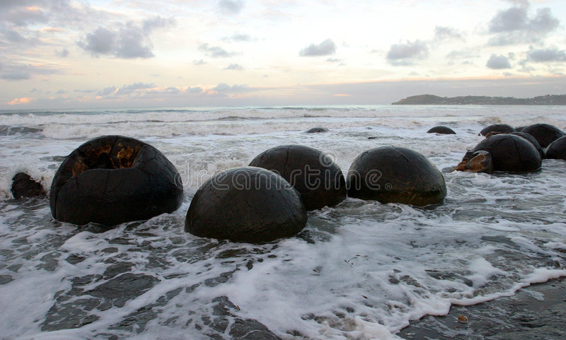 Moeraki Boulders, NZ. Moeraki Boulders, New Zealand, spherical geological formations stock photos