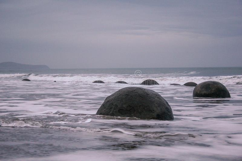Moeraki Boulders in Otago, South Island, New Zealand. Famous round stones at the beach royalty free stock photo