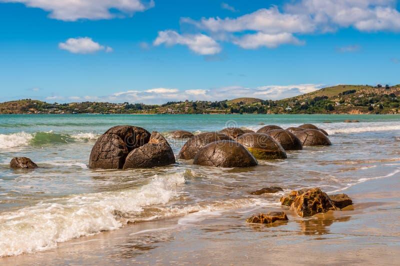 Moeraki Boulders in Otago, South Island of New Zealand. Unusually large and spherical Moeraki boulders lying along the beach on Otago coast, New Zealand. These royalty free stock images