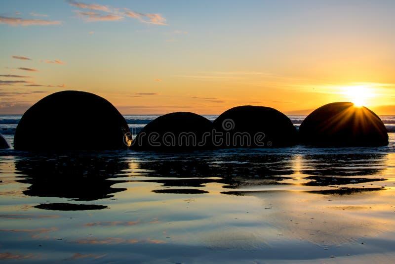 Moeraki boulders. At summer sunrise, Otago, New Zealand royalty free stock photos