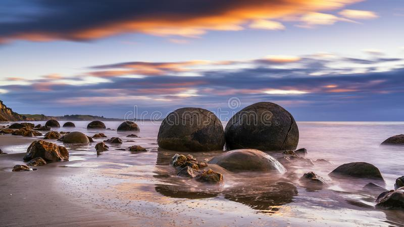 Moeraki Boulders at Sunrise. I came to Moeraki Beach after the storm on April 7, 2018. It is 40 kilometers from south Oamaru, New Zealand. There were a lot of royalty free stock photo