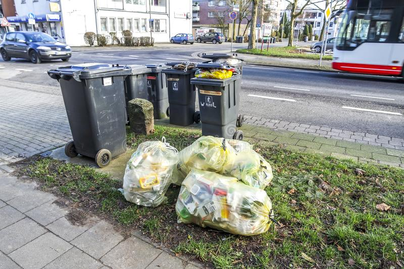 Moers , Germany - February 09 2018 : Typical german waste bags waiting in the street. To be picked up for recycling royalty free stock photography