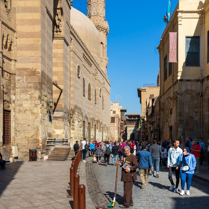 Moez Street with Barquq mosque and Sabil of Katkhuda historic building at far end, Cairo, Egypt stock photos