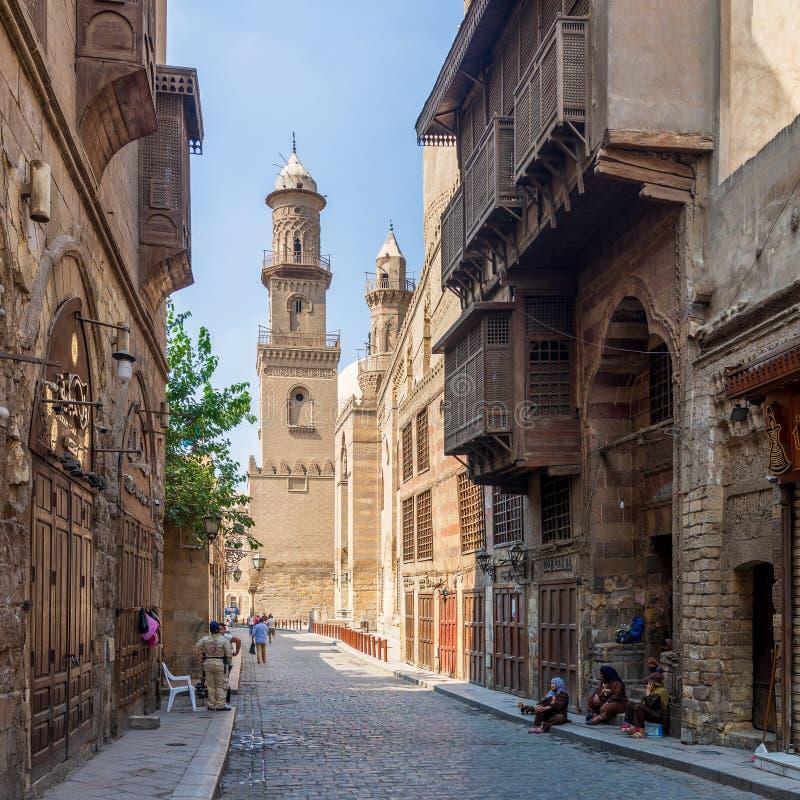 Moez Street with minaret of Qalawun Complex historic building, Cairo, Egypt stock photo