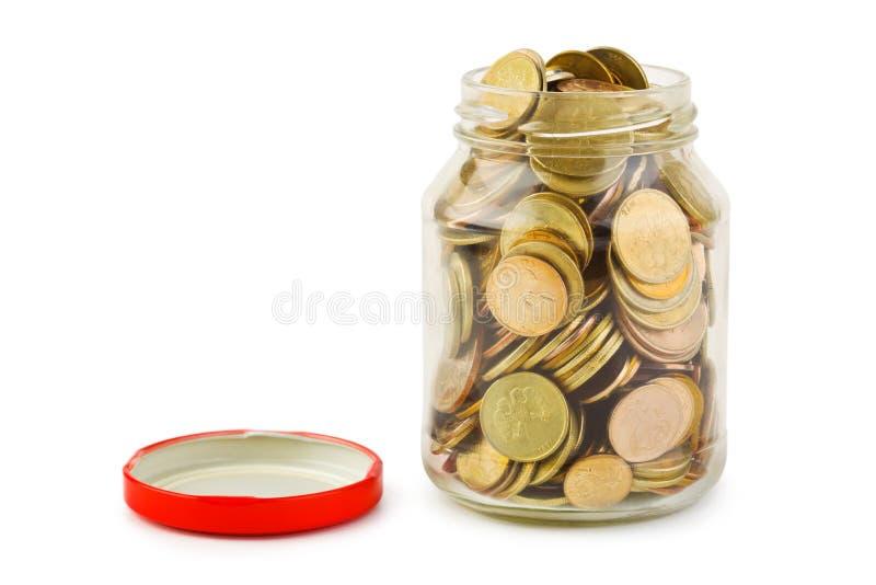 mogą monety szklane zdjęcie stock