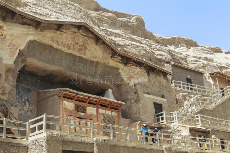 Mogao Caves in Dunhuang, China. This photo is taken in Dunhuang, China, The Mogao Caves Chinese: 莫高窟; pinyin: Mògāo kū; Wade–Giles stock photography