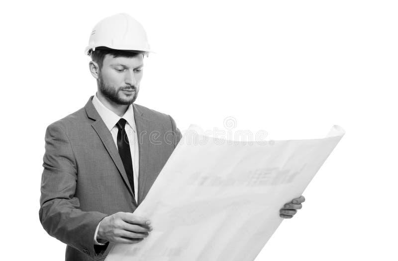 Mogen manlig arkitekt med en ritning arkivfoto