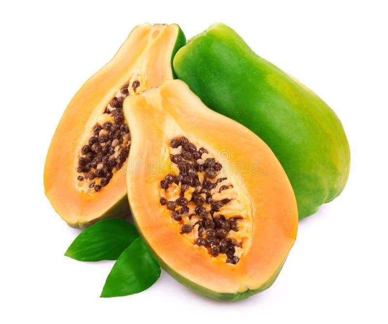 Mogen papaya på vit arkivbild