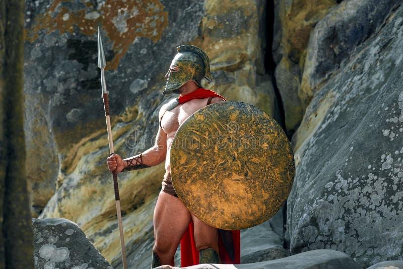 Mogen spartansk krigare i träna arkivfoton