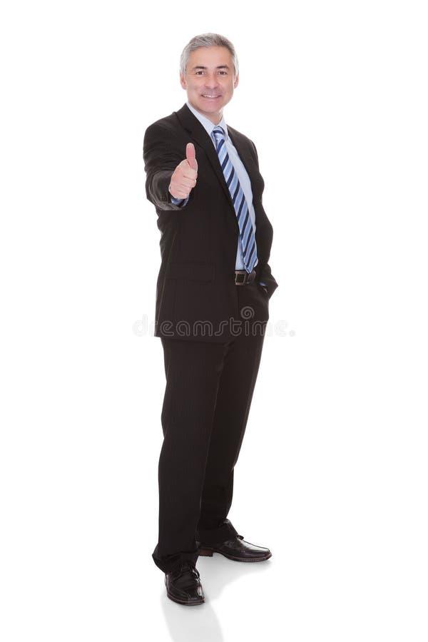 mogen stående för affärsman arkivbild