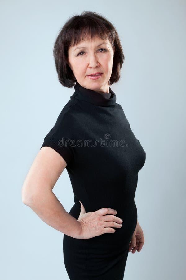 mogen ståendekvinna royaltyfri foto