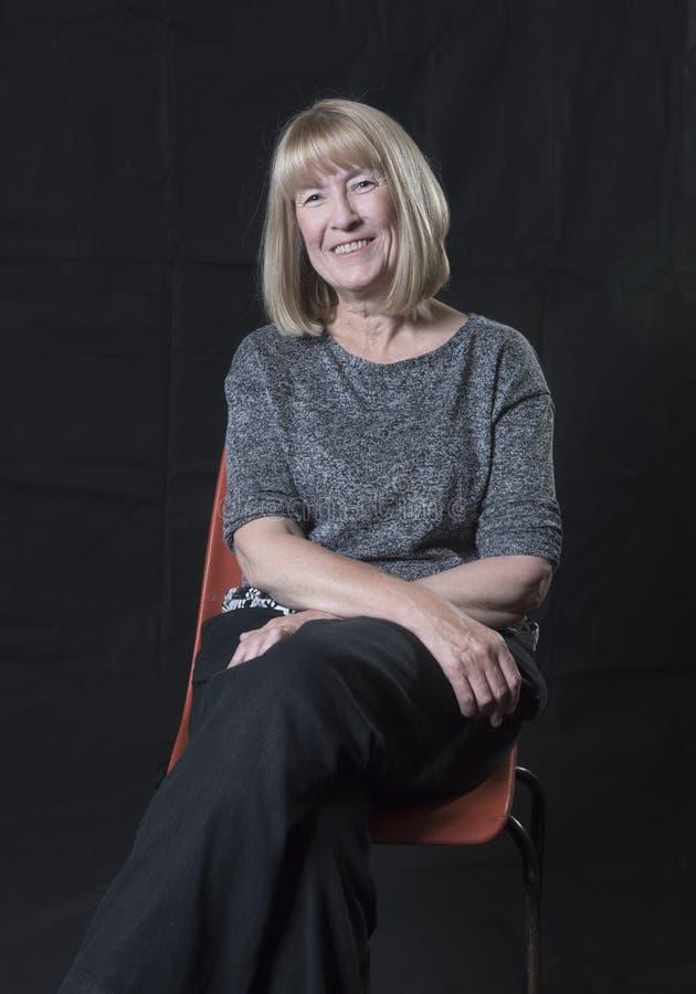 Moget blont le för kvinna royaltyfri fotografi