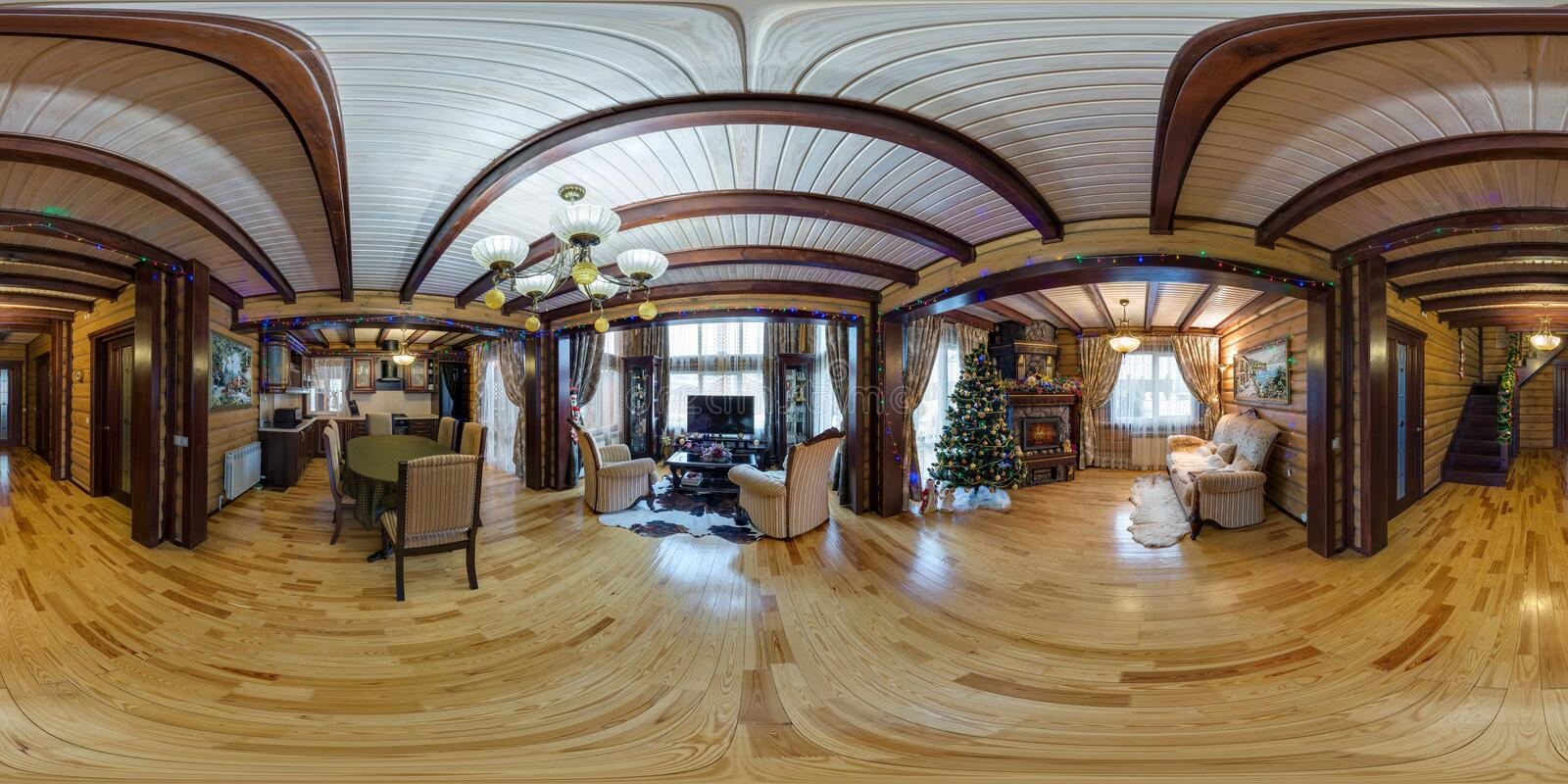 MOGILEV, BELARUS - DECEMBER, 2017: Full spherical seamless panorama 360 degrees angle view in interior of wooden rustic hall in. Vacation house equirectangular stock photography