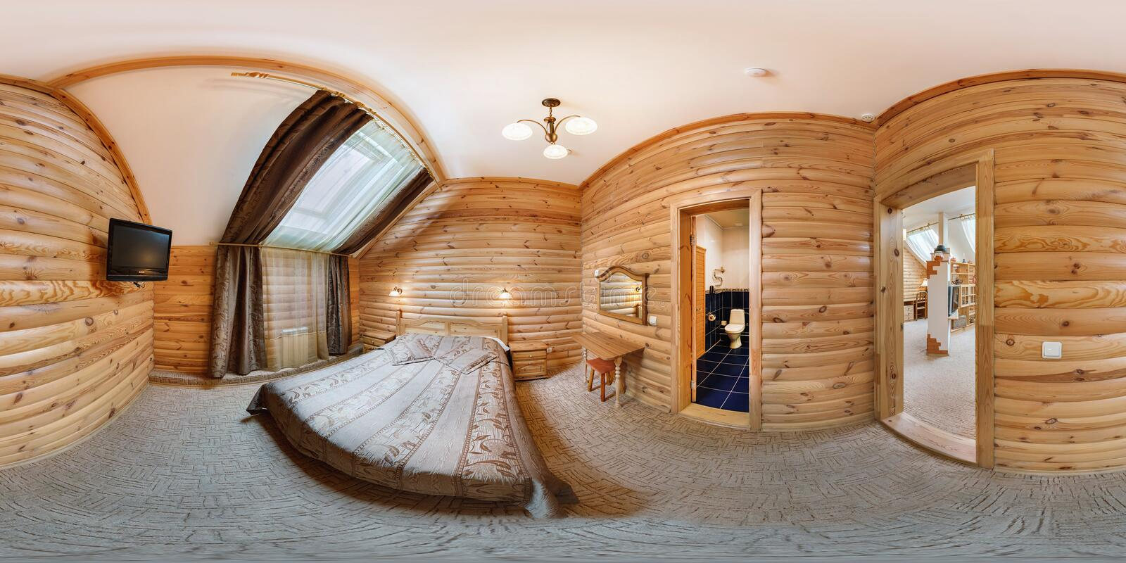 MOGILEV, BELARUS - JUNE 18, 2012: Panorama in interior stylish room in hotel in rustic wood style. Full 360 degree seamless. Panorama in equirectangular royalty free stock photography