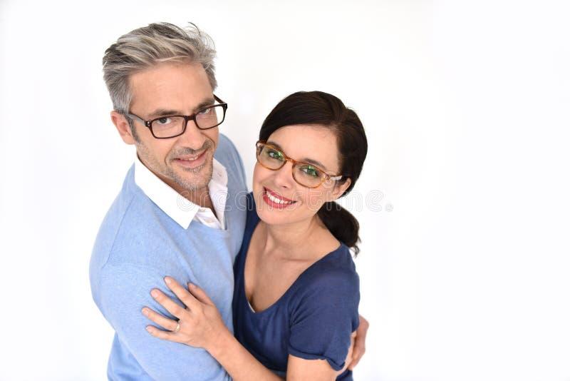 Mogna par med glasögon fotografering för bildbyråer