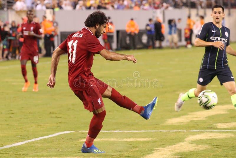 Mohammed Salah #11of Liverpool FC in der Aktion gegen Manchester City während Meisterschaftsdes spiels des International-2018 lizenzfreies stockbild