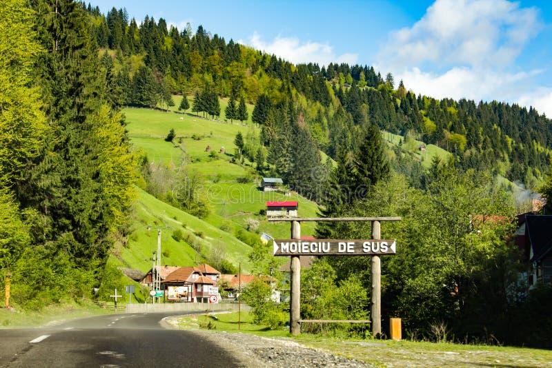 Moieciu de sus landscape. Village entrance, Brasov, Romania royalty free stock photo
