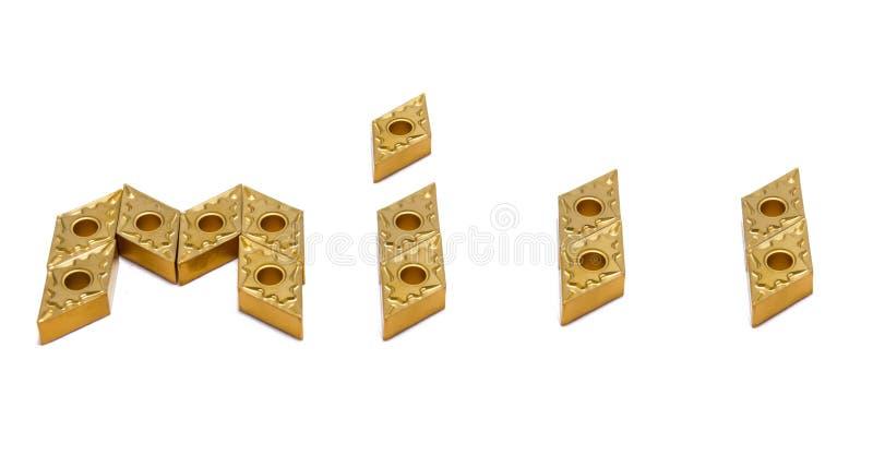 Moinho da palavra das ferramentas do torno do ouro fotografia de stock royalty free