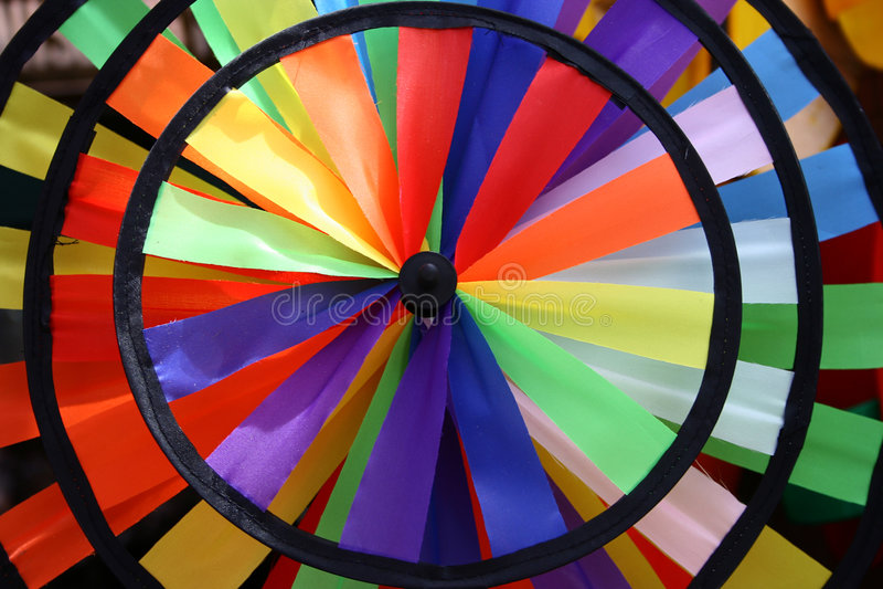Moinho de vento do brinquedo do arco-íris fotos de stock