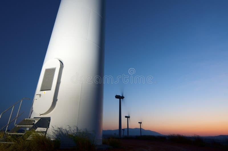 Moinhos de vento no nascer do sol fotografia de stock royalty free