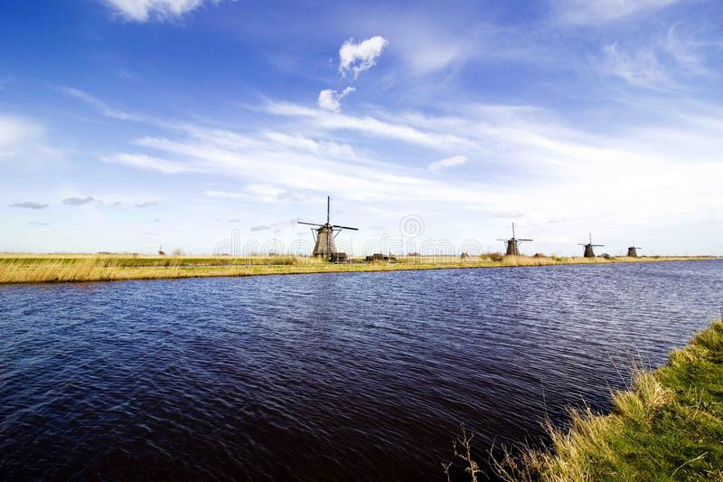 Moinhos de vento pelo rio foto de stock royalty free