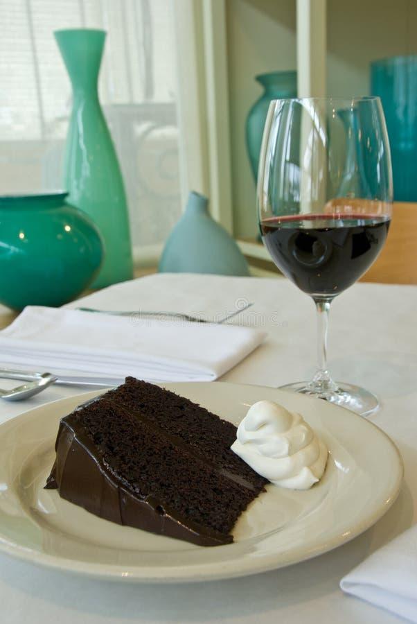 Moist chocolate cake. With chocolate icing stock photos