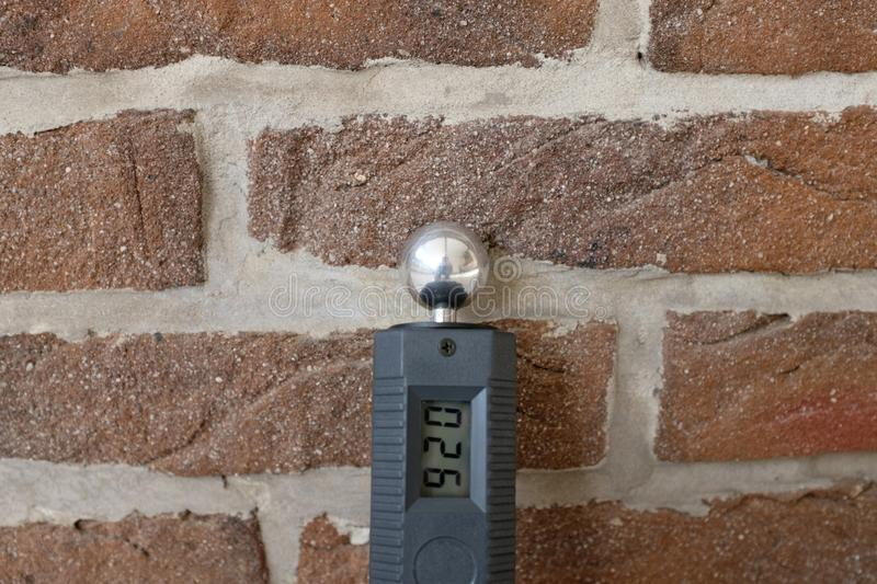 Moisture meter on a wall royalty free stock photography