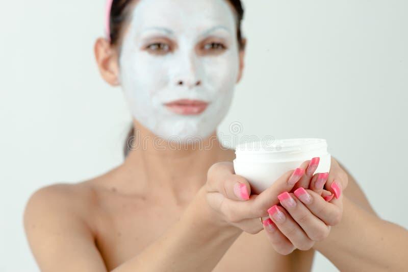 moisturizing kvinna för framsida royaltyfria foton