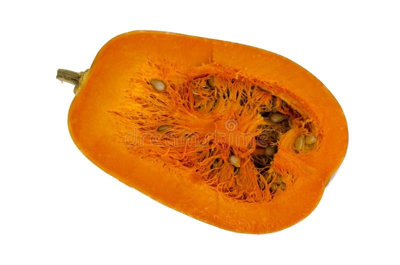 Moitié de potiron orange mûr de noix de muscade avec des graines photos stock