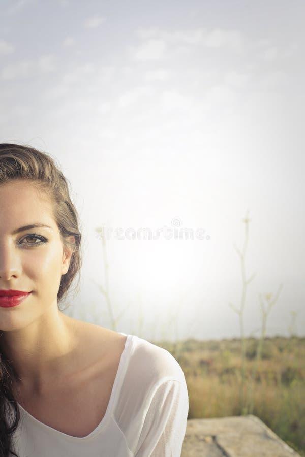 Moitié-portrait d'une femme images stock