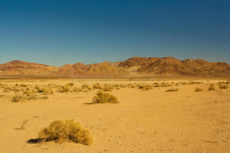 Mojave Desert. Generic image of the Mojave Desert (California). Desolate landscape with desert vegetation and mountains in the background stock photography