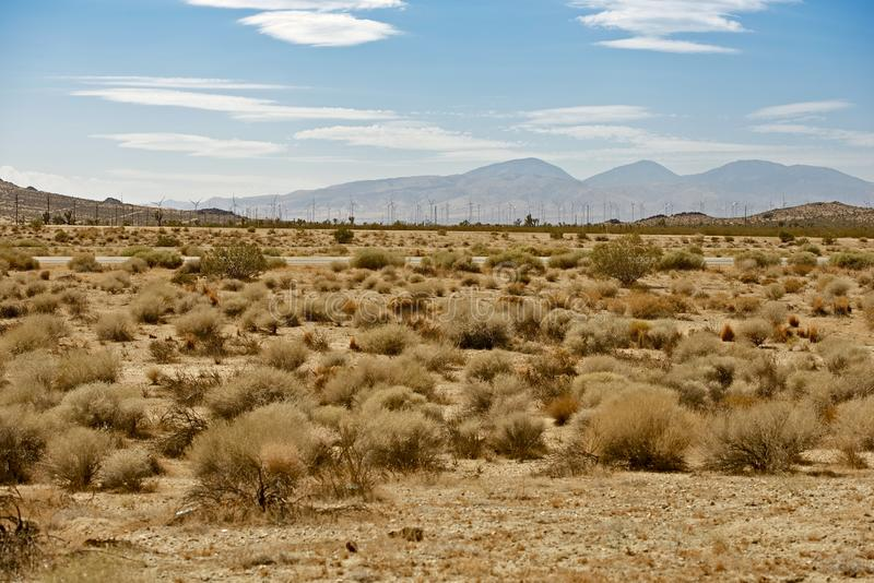 Mojave Desert US14. Hwy - Mojave Desert and Wind Turbines Plantation. Mojave, California, USA royalty free stock images