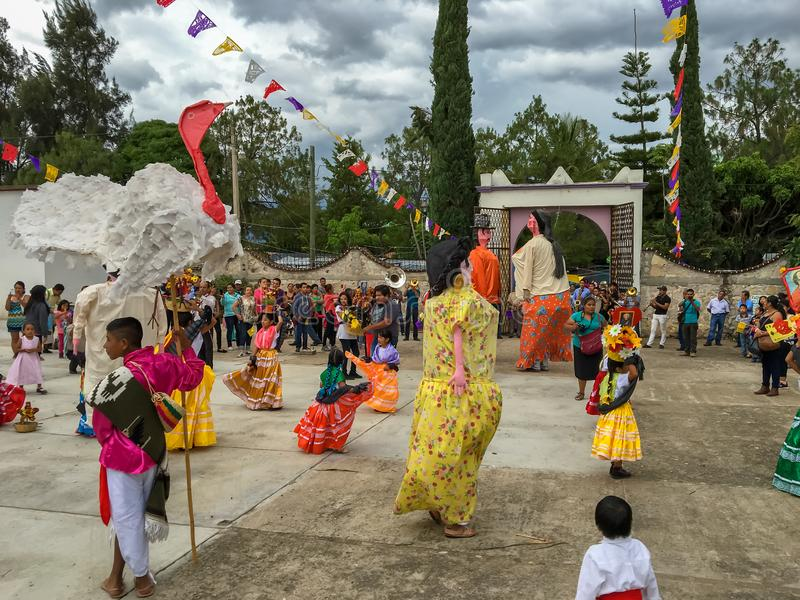 Mojigangas and children dancing at Calenda San Pedro in Oaxaca. stock photos