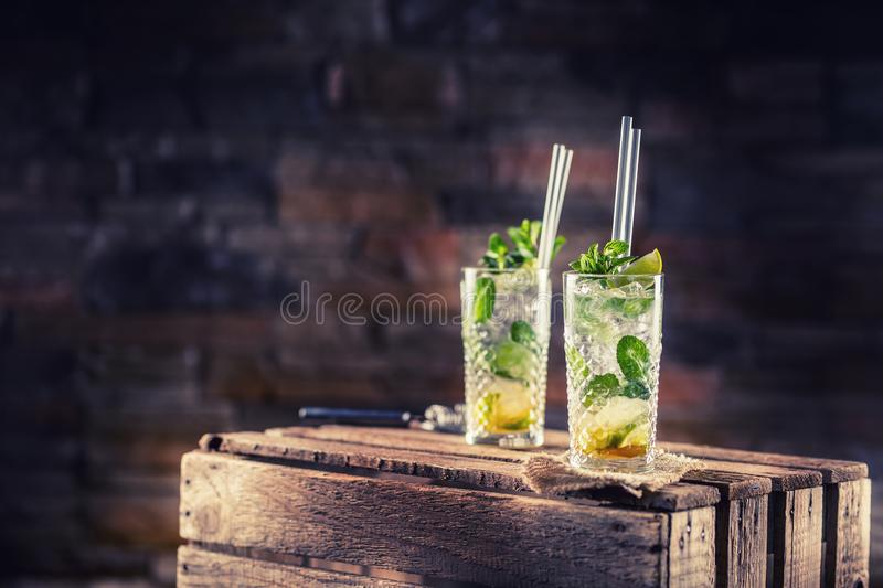 Mojito. Alcoholic cocktail drink mojito on wooden board in pub o royalty free stock image