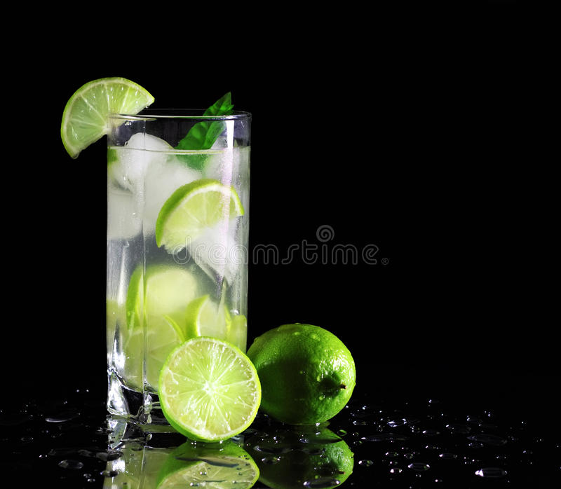 Mojito cocktail with fresh limes royalty free stock photo