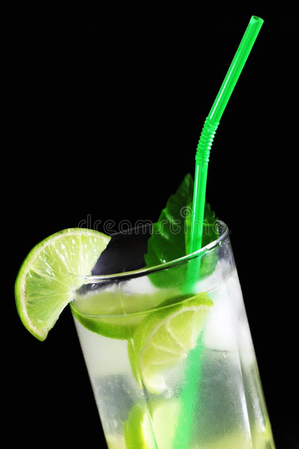 Mojito cocktail with fresh limes royalty free stock image