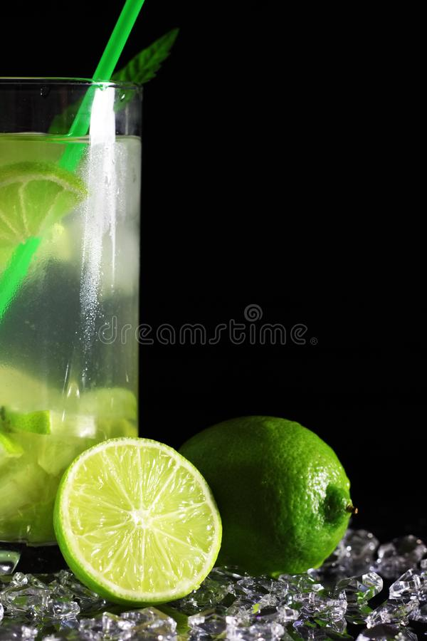 Mojito cocktail with fresh limes stock image