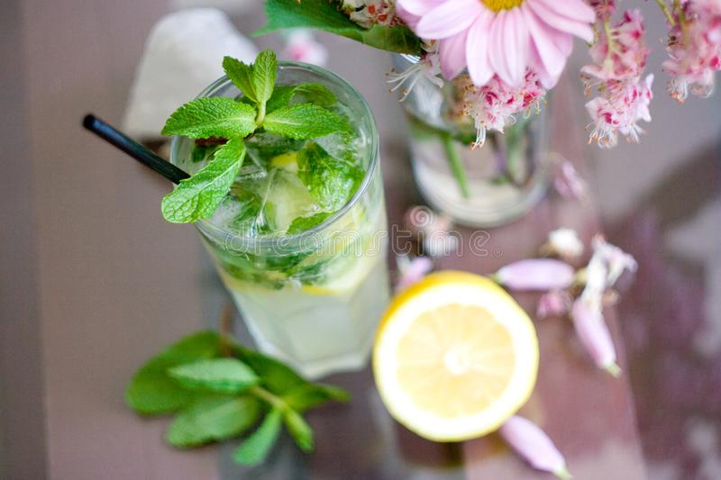 Mojito cocktail with lemon on table. stock photography