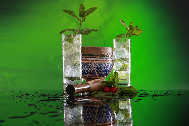 Mojito cocktail, muddler and bongo royalty free stock photos