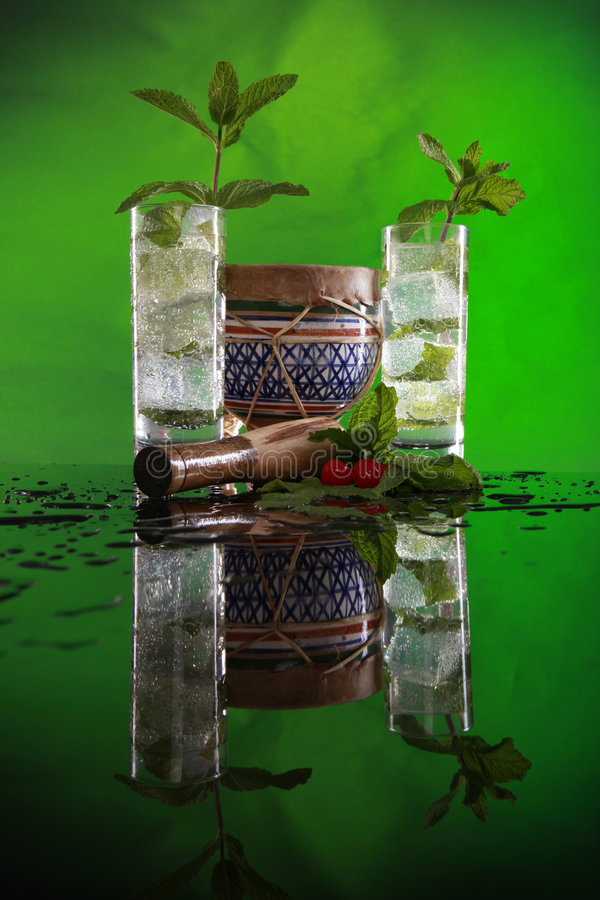 Mojito cocktail, muddler and bongo royalty free stock image