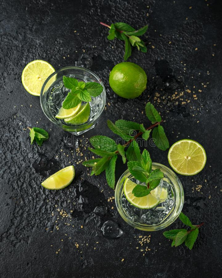 Mojito cocktail with Rum, lime and mint in glass. Summer cold drink with ice stock images